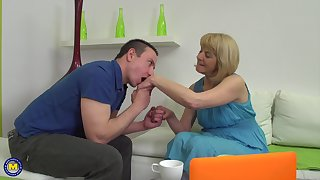 Short haired clumsy mature blonde Meriska B. rides a hard cock